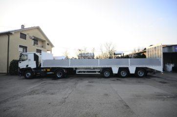 UNIT poluprikolica (navoz) UniMachine ST 3A sa hidrauličnom rampom i BDF ključevima za transport kontejnera 3